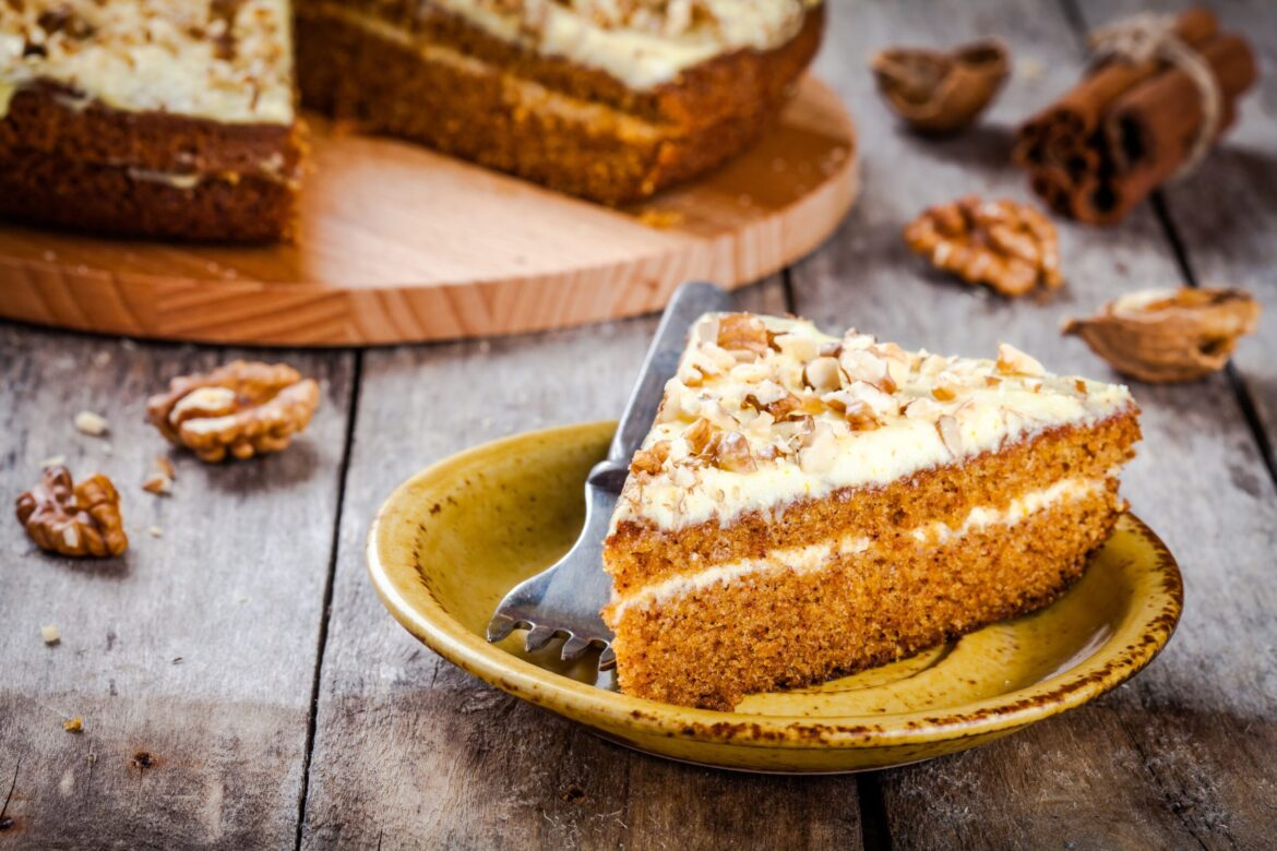 Piece of homemade carrot cake with walnuts